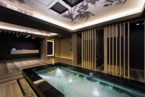 The swimming pool at or close to Hotel Zen Machida (Adult Only)