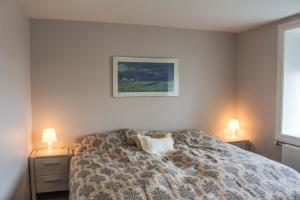 A bed or beds in a room at Olafsvik Apartments