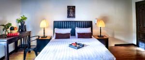 Ein Bett oder Betten in einem Zimmer der Unterkunft Villa Samnang