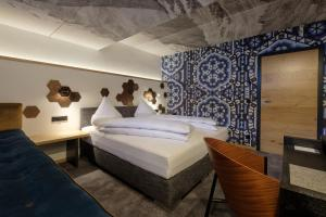 A bed or beds in a room at Boutique Hotel Gams