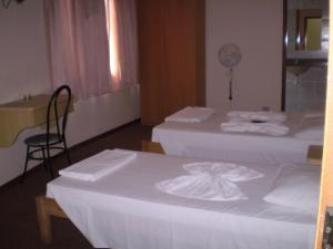 A bed or beds in a room at Barão Palace Hotel