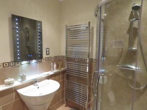 A bathroom at The Barn @ The Coach House