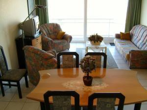 Ein Sitzbereich in der Unterkunft Residence Scorpio