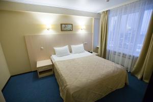 Кровать или кровати в номере Гостиница Брянск