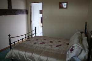 A bed or beds in a room at Le Prestige Bed & Breakfast