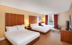 A bed or beds in a room at Hilton Maidstone