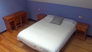 Cama o camas de una habitación en Posada de Roncesvalles