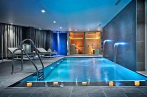 The swimming pool at or near Golden Tulip Sophia Antipolis - Hotel & Spa
