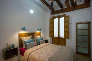 Cama o camas de una habitación en Eco-Friendly Apartments