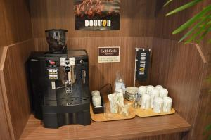 Coffee and tea-making facilities at Hotel Route-Inn Ube