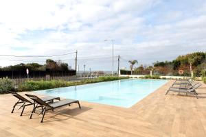 The swimming pool at or near Eurostars Cascais