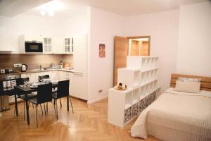 A kitchen or kitchenette at Smichov apartments   PragueStars