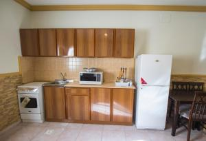 A cozinha ou cozinha compacta de سرب النورس للوحدات السكنية