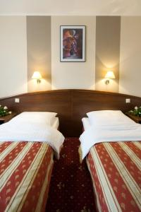 A bed or beds in a room at Hotel Novum & Spa