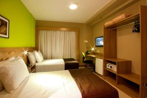 Cama ou camas em um quarto em Comfort Hotel Sertãozinho