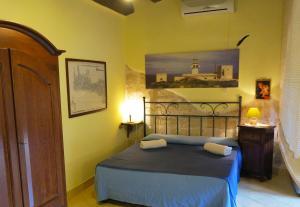 Cama o camas de una habitación en Lisola Residence