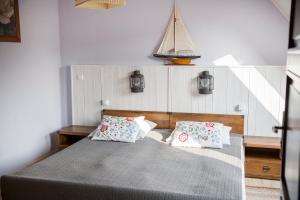 Łóżko lub łóżka w pokoju w obiekcie Dom Wakacyjny Mistral