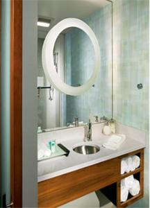 A bathroom at SpringHill Suites by Marriott Las Vegas North Speedway