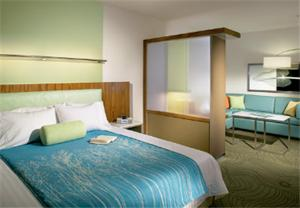 A bed or beds in a room at SpringHill Suites by Marriott Las Vegas North Speedway