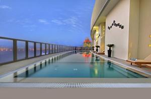 The swimming pool at or near The Curve Hotel