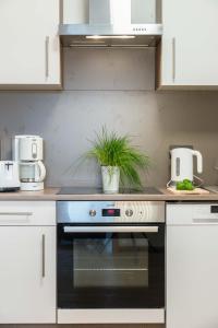 A kitchen or kitchenette at My Hostel