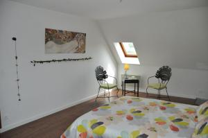 A bed or beds in a room at La ferme d'aristide