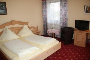 Ein Bett oder Betten in einem Zimmer der Unterkunft Landgasthof Hotel Bechtel