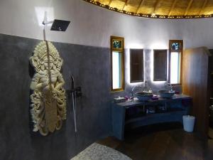 A bathroom at Puri Dajuma Villas
