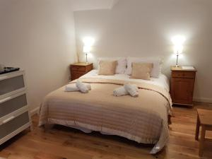 A bed or beds in a room at Hazel Residence
