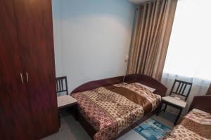 Кровать или кровати в номере Reis Hotel