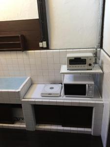 小楽庵にあるキッチンまたは簡易キッチン