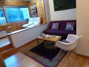 A seating area at Apartment La Molina