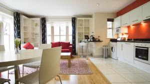 A kitchen or kitchenette at Brennan Court Guest Accommodation