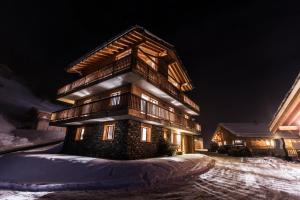 Swiss Alps Village Sarl during the winter