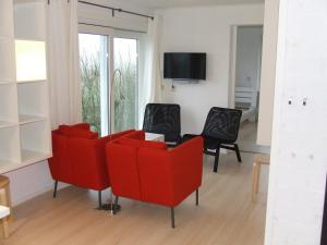 Ein Sitzbereich in der Unterkunft De Viool