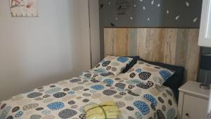 A bed or beds in a room at Apartamento Cigüeña
