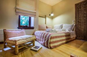 A bed or beds in a room at Kalderimi Country House