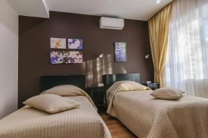 """Кровать или кровати в номере парк-отель """"Хамовники"""""""