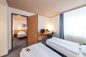Ein Bett oder Betten in einem Zimmer der Unterkunft Novum Hotel Seegraben Cottbus
