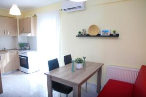 A kitchen or kitchenette at Apartments Holiday