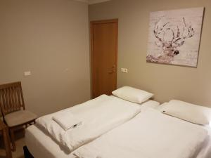 A bed or beds in a room at Laufás Guesthouse