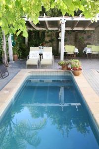 The swimming pool at or near Centre-Ville Guest House