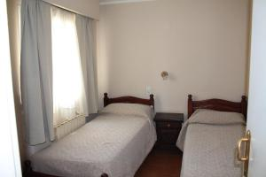 A bed or beds in a room at Cabo Vírgenes