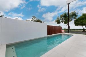 The swimming pool at or near Arlington Beach House