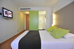 A bed or beds in a room at Campanile Málaga Airport