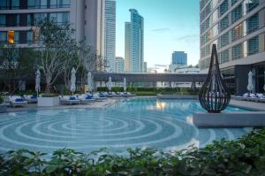 The swimming pool at or near Bangkok Marriott Marquis Queen's Park