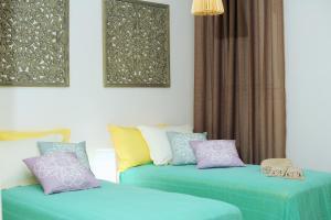 Łóżko lub łóżka w pokoju w obiekcie Lidia Villa
