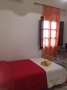 A bed or beds in a room at B&B Is Janas E5391