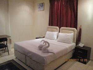 Cama ou camas em um quarto em Masat Al Mohand Al Rouda