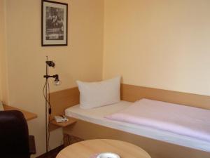 Кровать или кровати в номере Hotel Gesellschaftshaus